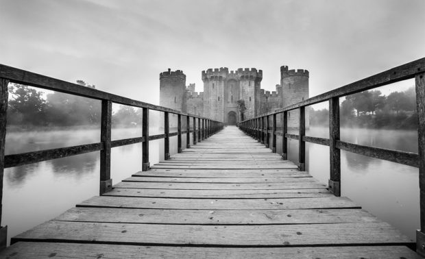 Bodiam Castle at sunrise in black and white by Tracy Howl www.tracyhowl.com